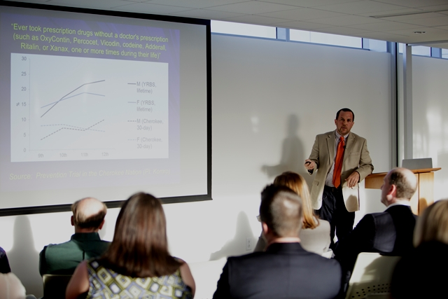 "Chris Delcher, Ph.D., adjunct research assistant professor in the Department of Health Outcomes and Policy, presents data on rates of prescription drug use without prescriptions in his presentation ""Florida Trends in Pain Reliever Prescriptions and Mortality Among Adolescents."""