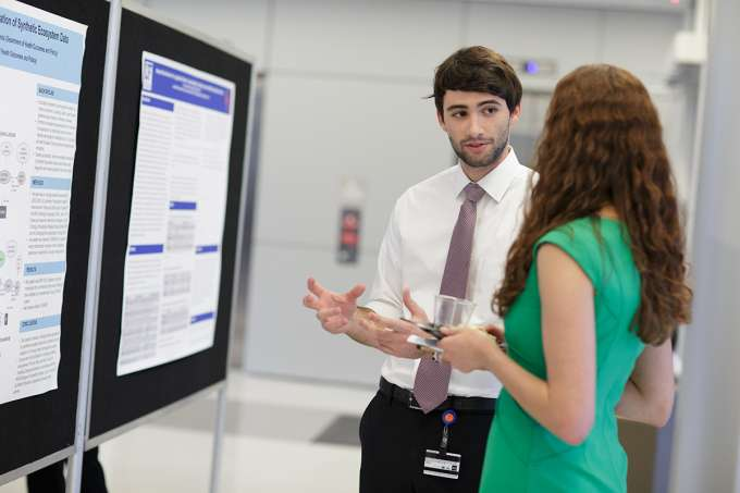 Daniel Welch, a medical student in the UF College of Medicine, explains the research he conducted on ontological representations of synthetic ecosystem data together with Bill Hogan, Ph.D., professor in the Department of Health Outcomes & Policy, and Amanda Hicks, Ph.D., assistant professor in the Department of Health Outcomes & Policy.